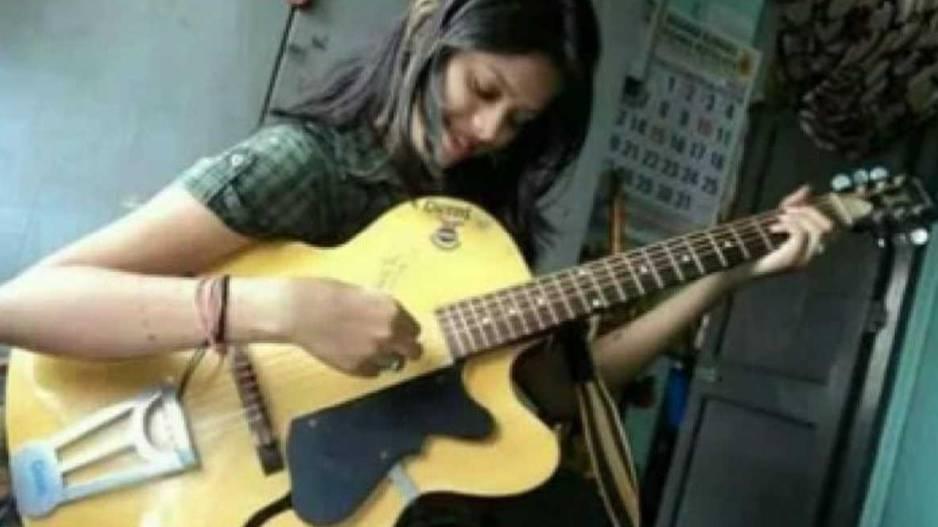 Antara Chakraborty Playing Guitar