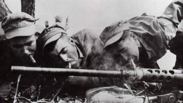 Soldiers Lighting Cigarettes From Overheated Gun Barrel